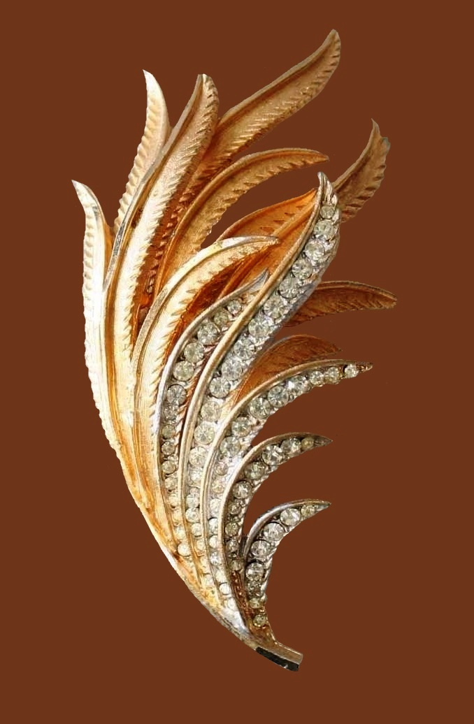 Textured gold-tone leaf brooch decorated with rhinestones