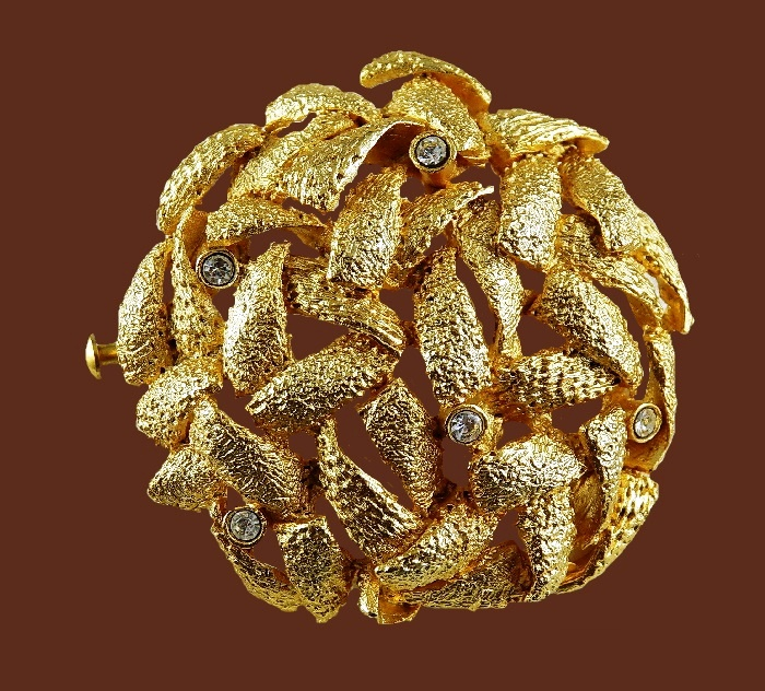 Textured jewelry alloy of gold tone brooch decorated with crystals