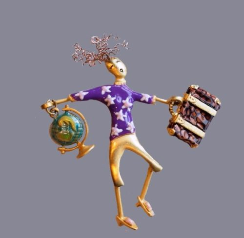 Traveler brooch. A girl with a globe and a suitcase. Jewelry alloy, enamel