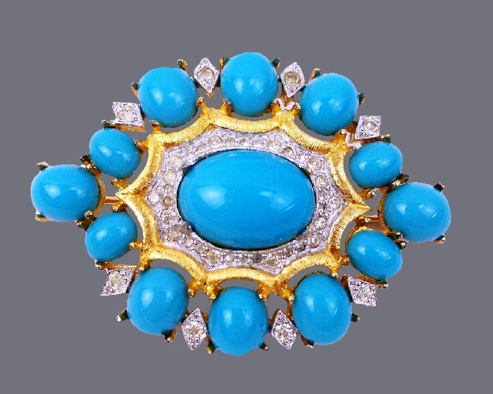 Turquoise color cabochon oval brooch. Gold tone metal, rhinestones