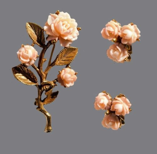 Vintage luxury set of brooch and clips of jewelry alloy with a coating, inserts - celluloid roses. 1960s