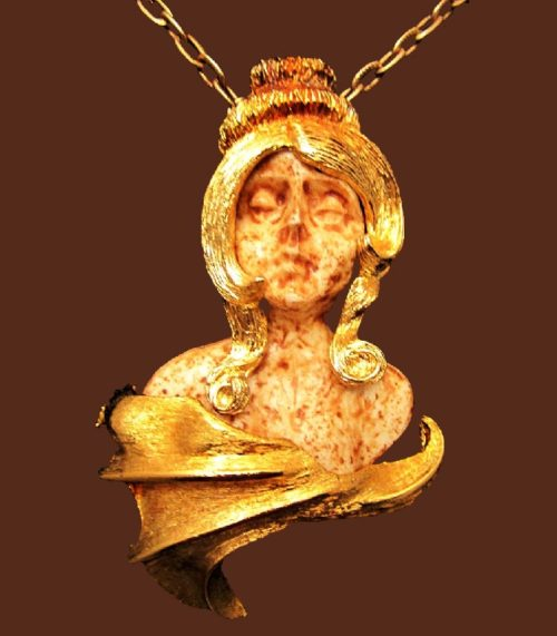 Virgo Zodiac sign pendant made of gold tone jewelry alloy and resin