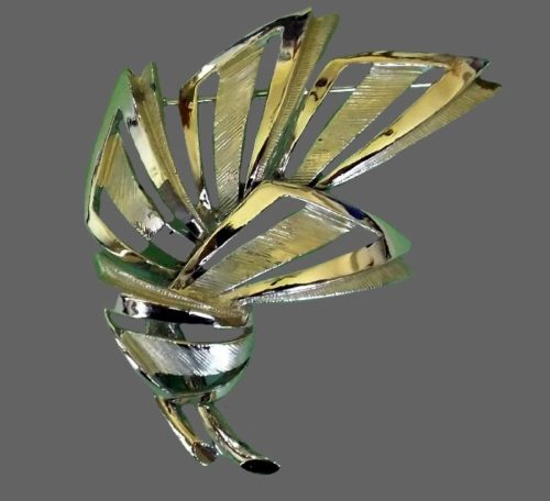 Abstract design gold and silver tone brooch