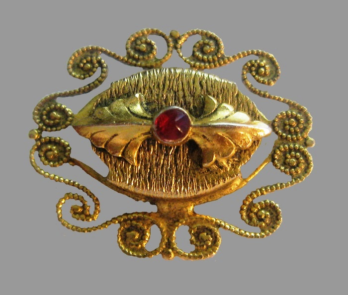 Antique Victorian style gold tone brooch with cabochon in the middle