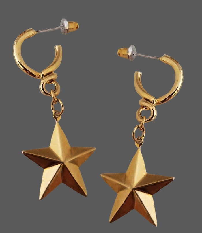 Aviance star dangle earrings of gold tone