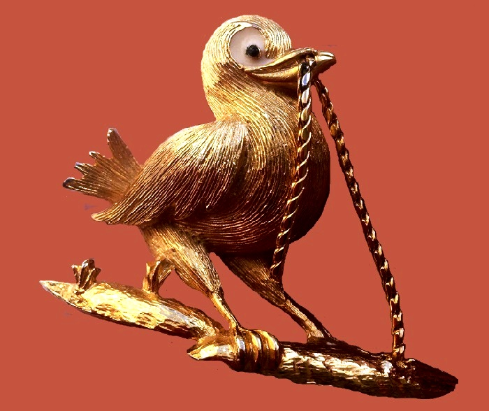 Bird with 'worm' brooch of gold tone. 1960s