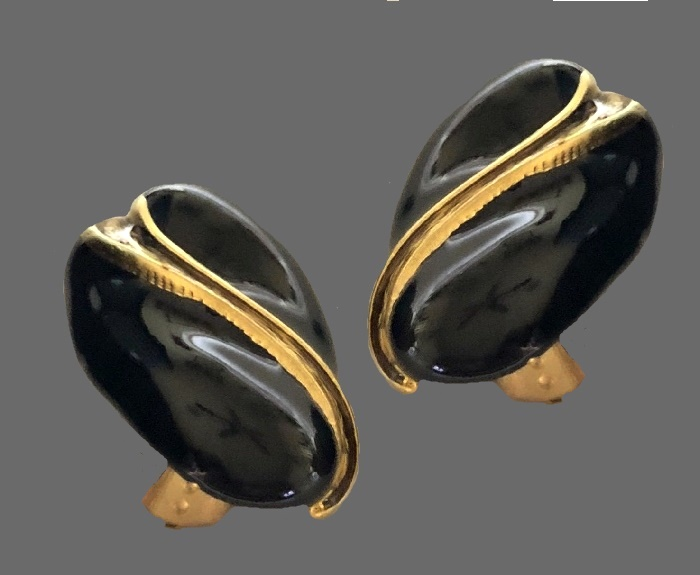 Black enamel and gold tone metal earrings of irregular shape