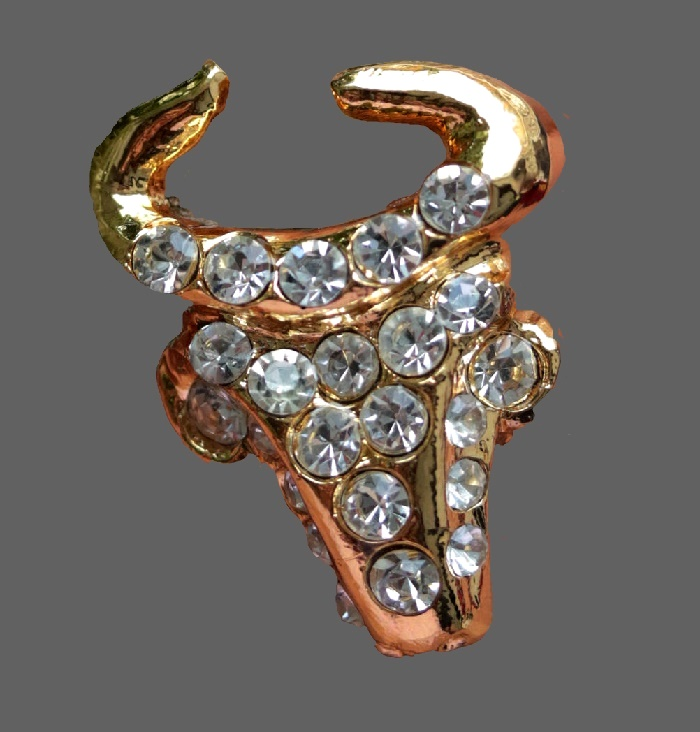 Bull's head gold tone brooch decorated with rhinestones. 5.5 cm. Marked Christian Lacroix CL Made in France
