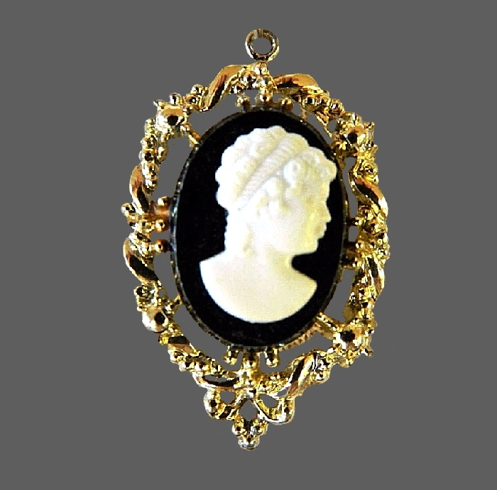 Cameo pendant of gold tone, black and white plastic