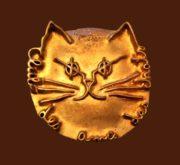 Cat's face inscription Flammarion Club Chat. Bronze gold plated brooch, 1999. Signed