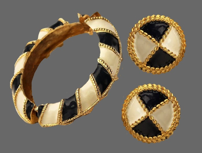 Clips and bracelet set. 1980s. Jewelry alloy of gold tone, black and white enamel. Bracelet 17 cm, clips 3.8 cm