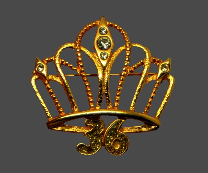 Crown brooch with numbers 36 at the bottom. Gold tone jewelry alloy, transparent crystals