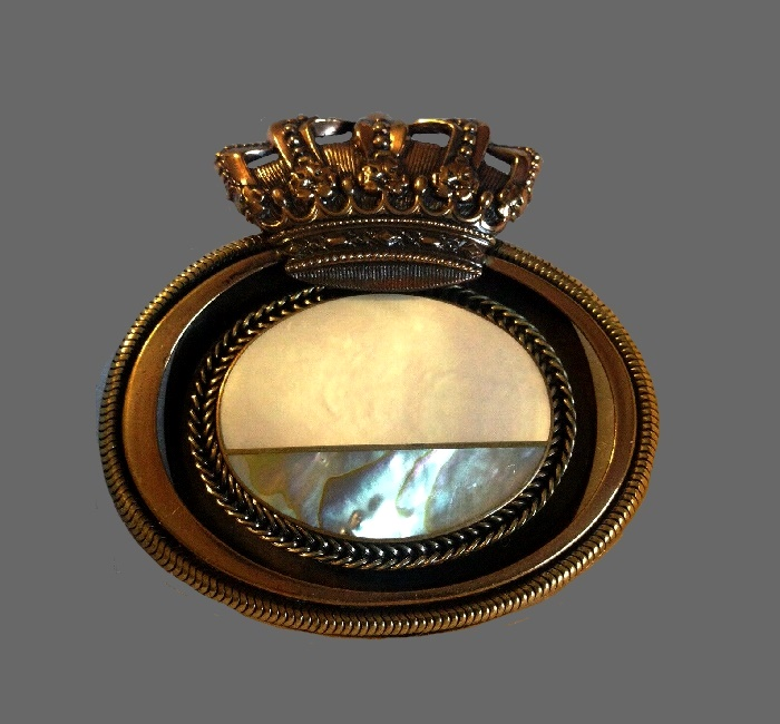 Crown topped oval brooch. Mother of pearl, metal, plastic