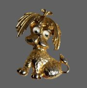 Dog with moving eyes pin of gold tone
