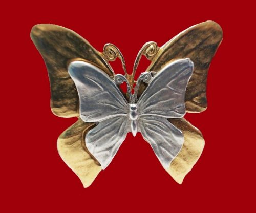 Double butterfly brooch of jewelry alloy of gold and silver tone
