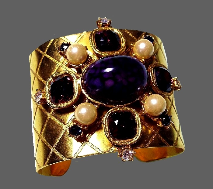 Eight-pointed cross bracelet. Purple cabochon, faux pearls, purple, cobalt and transparent crystals. Quilted pattern on jewelry alloy. 1980s