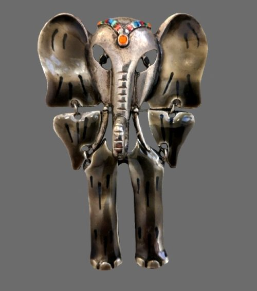 Elephant with moving parts brooch. Marked Don Lin. 9.5 cm. Volumetric trunk. Silver tone metal, enamel, crystals