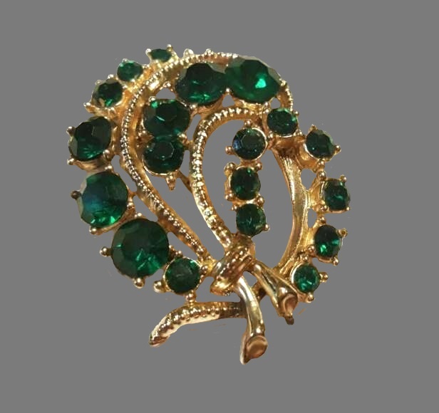 Emerald green rhinestone floral spray brooch of gold tone