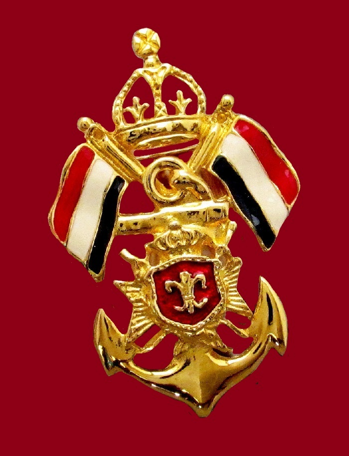 Enameled Heraldic style vintage brooch. Jewelry alloy, black, red and white enamel