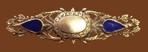 Exquisite leaf design brooch. Gold tone jewelry alloy, purple cabochons
