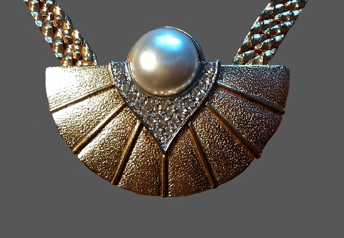 Fan shaped pendant. Textured gold tone metal, rhinestones