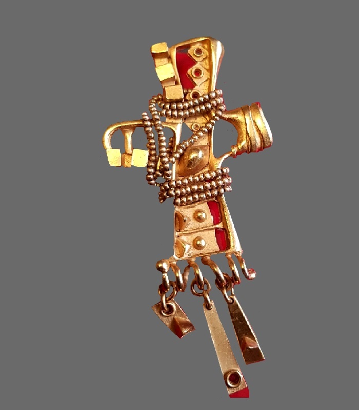 Fantasy brooch in the shape of a cross with charms. Jewelry alloy, gold plated