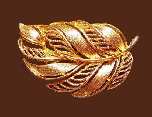 Filigree textured goldtone leaf brooch