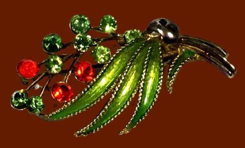 Floral spray brooch of gold tone, green enamel, rhinestones. 1960s