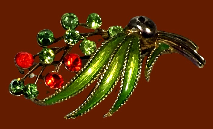 Floral spray brooch of gold tone, green enamel, rhinestones. 1960s