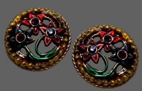 Framed flower round earrings. Gold tone textured metal, enamel