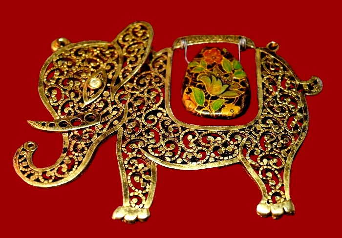 Gorgeous elephant pendant made of gold tone filigree metal, rhinestone, enamel and plastic