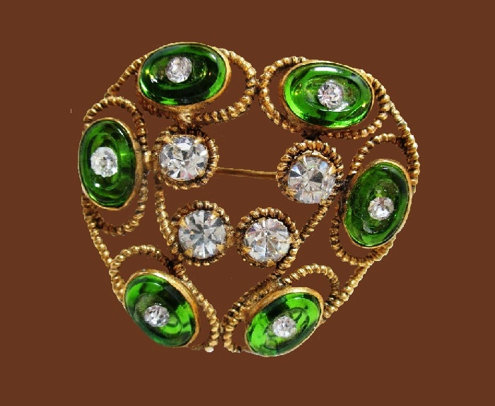 Heart shaped gold tone brooch decorated with green lucite and rhinestones