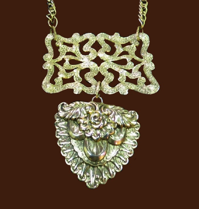 Large gold tone pendant