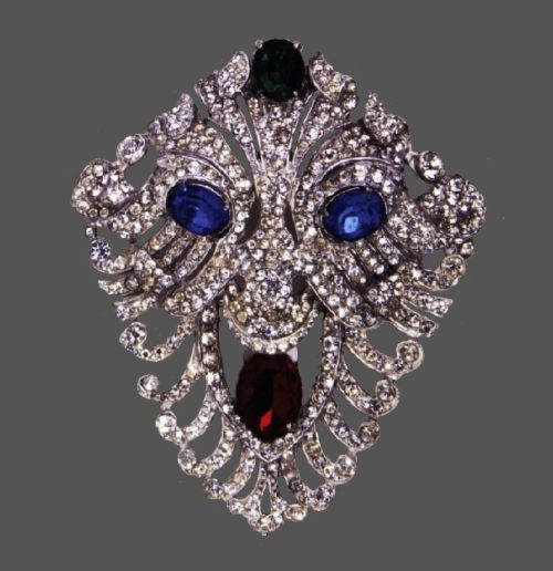 Lion's mask brooch. Rhodium plated metal, clear crystals, black and blue cabochons. 1940s