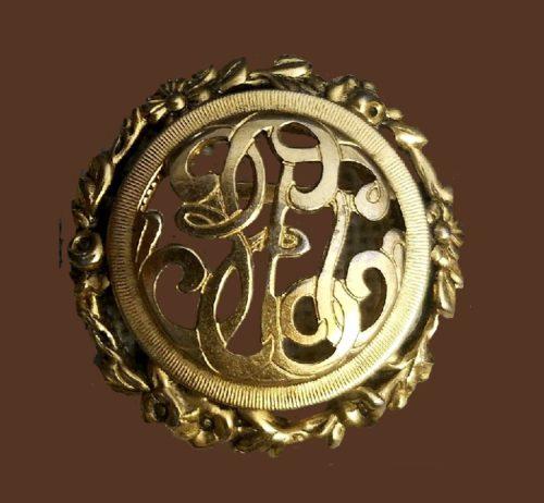 Monogram Style gold tone round brooch
