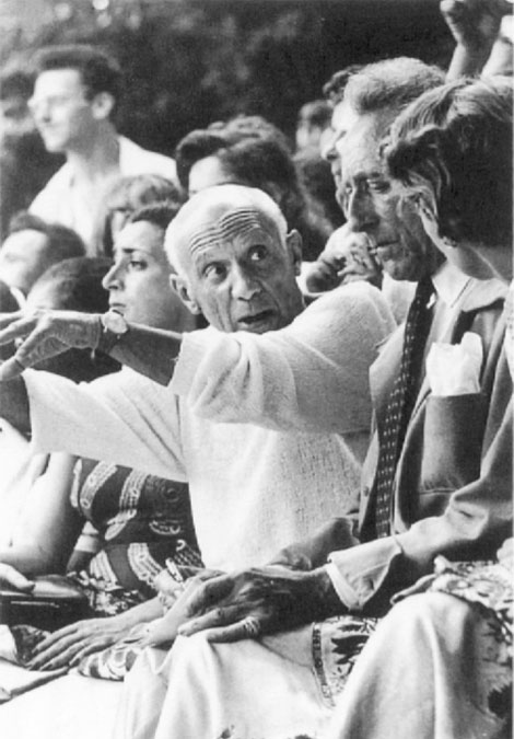 Picasso and Jean Cocteau in 1950s. Pay attention to his little finger and a trinity ring on it