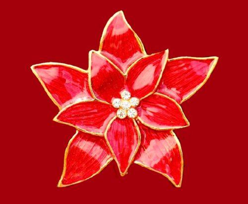 Poinsettia flower brooch. Gold tone jewelry alloy, red enamel