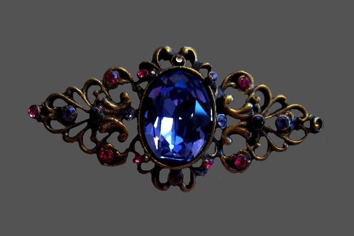 Purple cabochon classic Victorian design brooch. Brass tone, fuchsia rhinestones