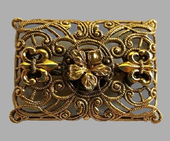 Rectangle gold tone brooch with filigree ornaments