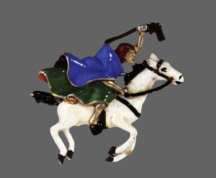 Rider brooch, 1940. Gold-plated metal brooch, blue, and green, white, red and black enamel. 6.5cm