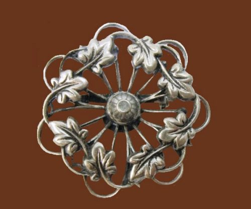 Round Filigree Leaf brooch of silver tone, 1960s