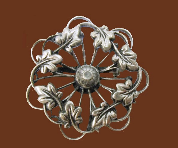 Round Filigree Leaf brooch of silver tone, 1960s