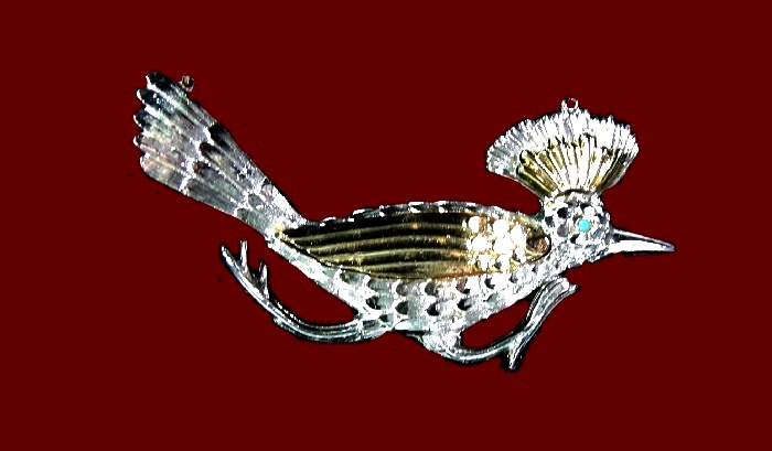 Running bird pendant. Silver and gold tone metal