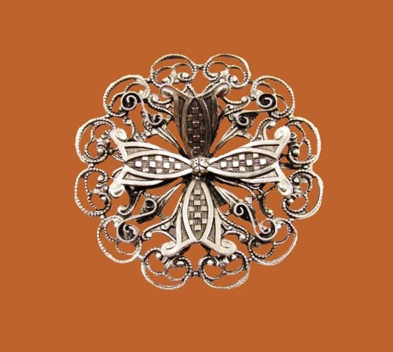 Silver filigree floral design brooch
