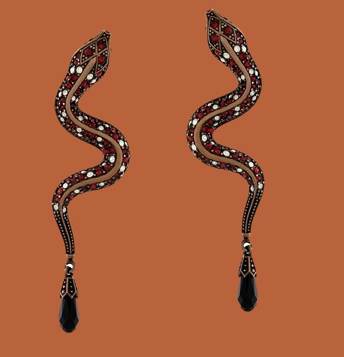 Snake earrings. Antique gold tone metal, crystals of ruby and opal tones, black drop-shaped crystal