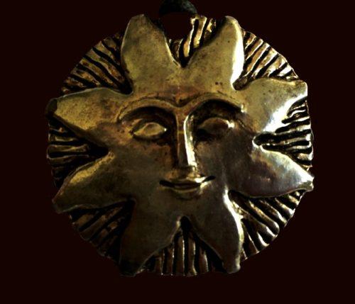 Solar pendant created by Jacky de Paris on Jean Cocteau design. Silver tone metal