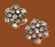 Star clip earrings of gold tone metal and rhinestones