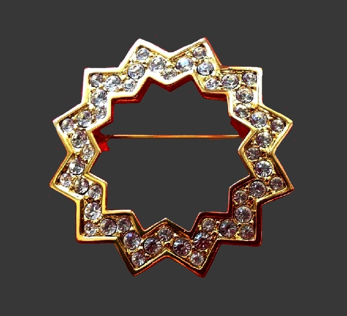 Star frame brooch. Jewelry alloy of gold tone, rhinestones. 3 cm