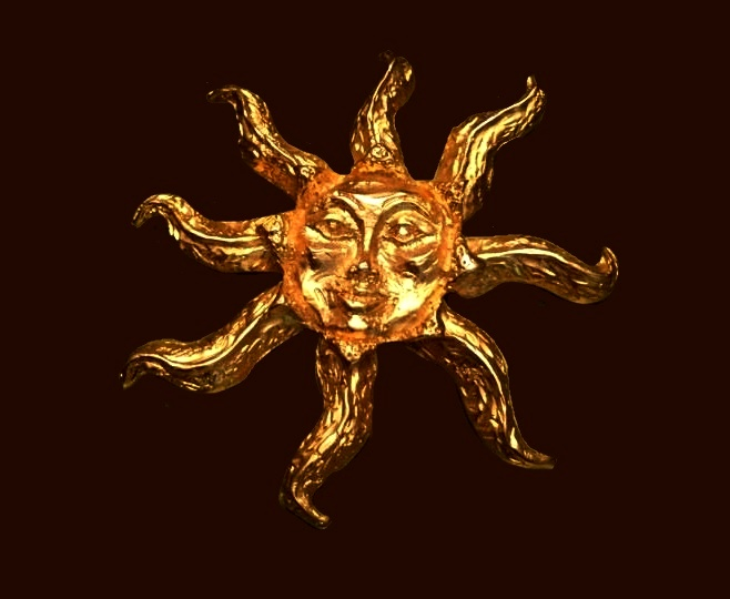 Sun gold tone brooch