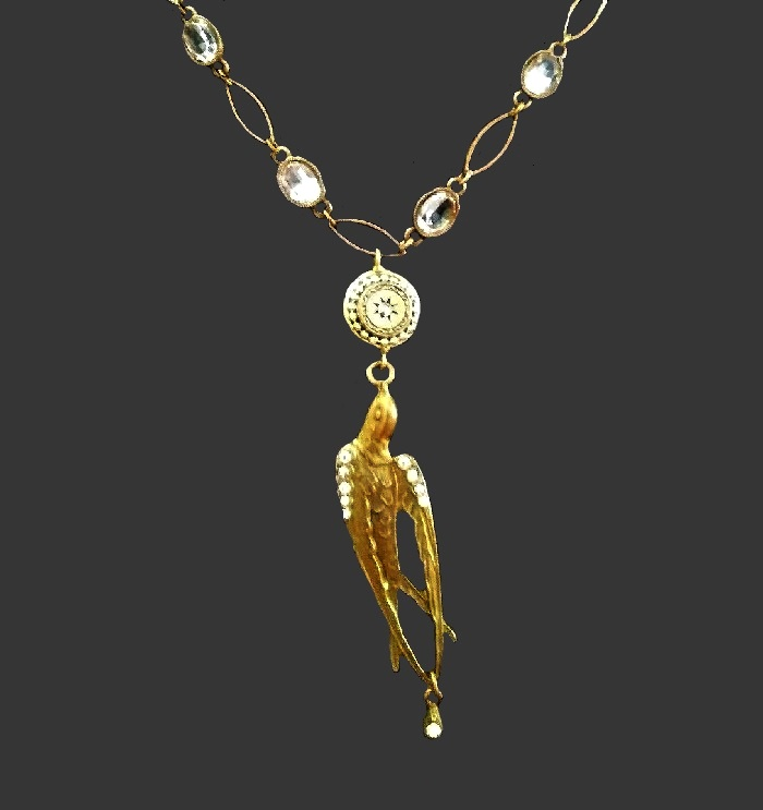 Swallow necklace of gold tone, rhinestones, crystals